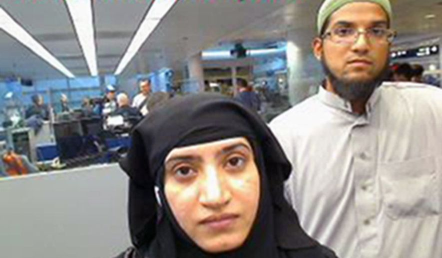 This July 27, 2014, file photo provided by U.S. Customs and Border Protection shows Tashfeen Malik, left, and Syed Farook, as they passed through O'Hare International Airport in Chicago. (U.S. Customs and Border Protection via AP, File)