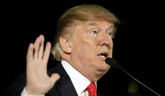 Republican presidential candidate Donald Trump speaks during a campaign rally at the Veterans Memorial Building, Saturday, Dec. 19, 2015, in Cedar Rapids, Iowa. (AP Photo/Charlie Neibergall) ** FILE **