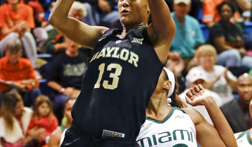 Baylor forward Nina Davis (13) makes a shot in front of Miami forward Erykah Davenport (30) during the first half of an NCAA college basketball game, Saturday, Dec. 19, 2015, in Winter Park, Fla. (AP Photo/John Raoux)