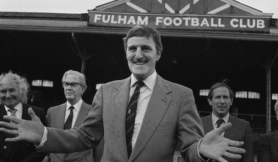 FILE - In this April 9, 1987 file photo shows footballer turned broadcaster Jimmy Hill at Fulham Football Club in London. Jimmy Hill, a former footballer, coach and union leader who ushered player-power and soaring salaries into the British game by masterminding the abolition of the maximum wage, has died. He was 87. Hill's family said he died Saturday Dec. 19, 2015 after a long battle with Alzheimer's Disease. (PA via AP, file) UNITED KINGDOM OUT