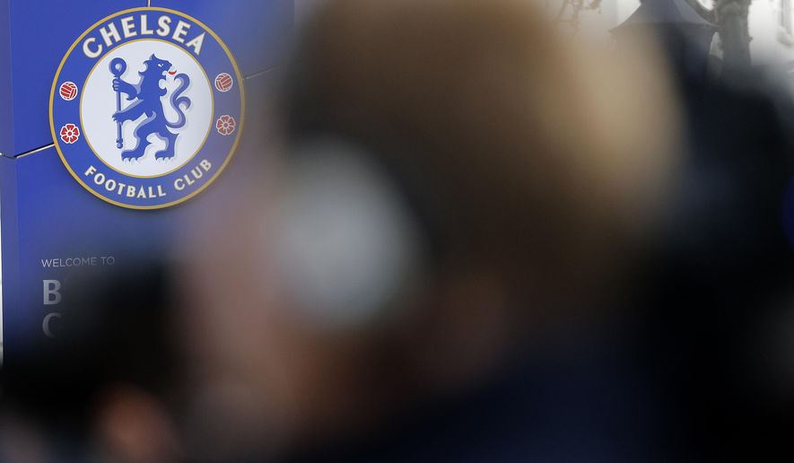 Journalists wait outside Stamford Bridge Stadium in London, Friday, Dec. 18, 2015. Chelsea head coach Jose Mourinho has left Chelsea with the club languishing one point above the relegation zone just seven months after winning the Premier League title. (AP Photo/Frank Augstein)