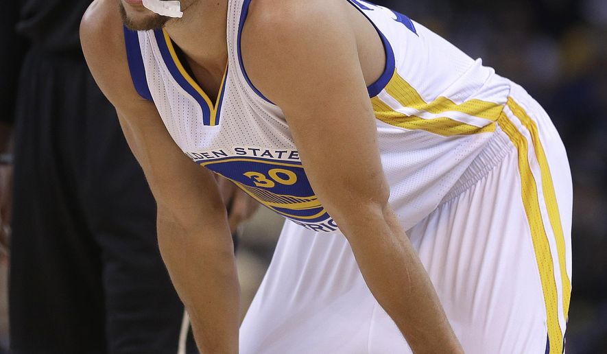Golden State Warriors' Stephen Curry waits for play to resume during the first half of an NBA basketball game against the Milwaukee Bucks on Friday, Dec. 18, 2015, in Oakland, Calif. (AP Photo/Ben Margot)