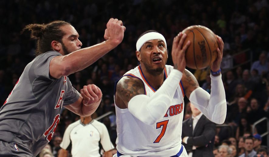 New York Knicks' Carmelo Anthony (7) drives to the basket against Chicago Bulls' Joakim Noah, left, during the first half of an NBA basketball game Saturday, Dec. 19, 2015, in New York. (AP Photo/Jason DeCrow)