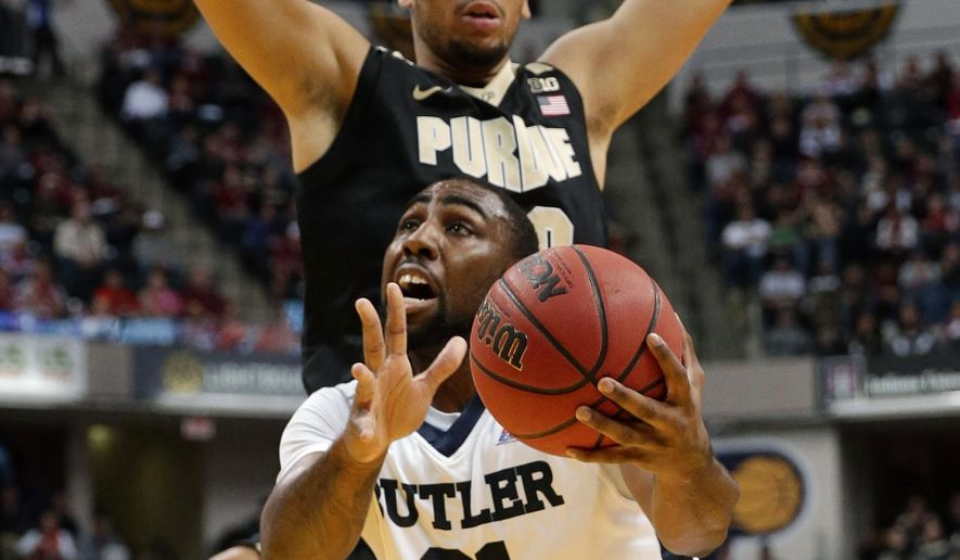 Butler forward Roosevelt Jones (21) goes under Purdue center A.J. Hammons (20) for a shot in the first half of an NCAA college basketball game in Indianapolis, Saturday, Dec. 19, 2015. (AP Photo/Michael Conroy)
