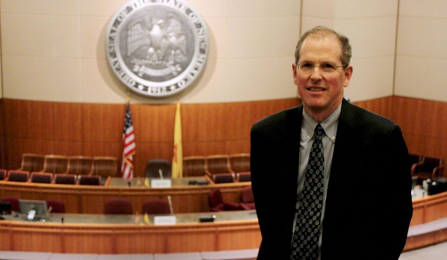 New Mexico Sen. Peter Wirth, D-Santa Fe, poses for a photograph in the Senate gallery at the State Capitol on Monday, Dec. 7, 2015, in Santa Fe, N.M. Wirth has been pushing since 2011 to update the state's campaign finance laws to require more disclosure by independent donors and groups. (AP Photo/Susan Montoya Bryan)