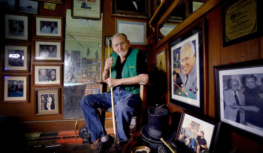 "ADVANCE FOR SUNDAY, DEC. 20 - In this photo taken Dec. 9, 2015, Frank ""Sailor"" Stellman, 88, poses for a photo in his pool room in Racine, Wis. He was inducted into the Straight Pool Hall of Fame in 2014. (Gregory Shaver/The Journal Times via AP) MANDATORY CREDIT"