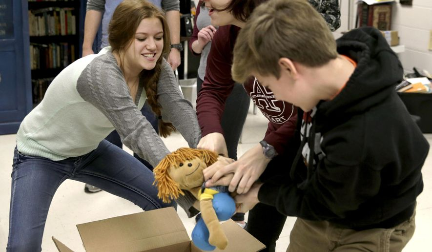 """Alyssa Jansen, playing Imogene Herdman, Leah Dreyer, playing Mother, and Aidan Buechler, playing Ralph Herdman, fight over a doll that is a stand in for the baby Jesus while rehearsing a scene for """"The Best Christmas Pageant Ever"""" during their Theater Seminar Production Class at Appleton North High School Tuesday, Dec. 8, 2015, in Appleton, Wis. Appleton North High School's theater program is one of the most successful in the state. The class will perform """"The Best Christmas Pageant Ever"""" at four different elementary schools in the area.  (Danny Damiani/The Post-Crescent via AP) NO SALES; MANDATORY CREDIT"""