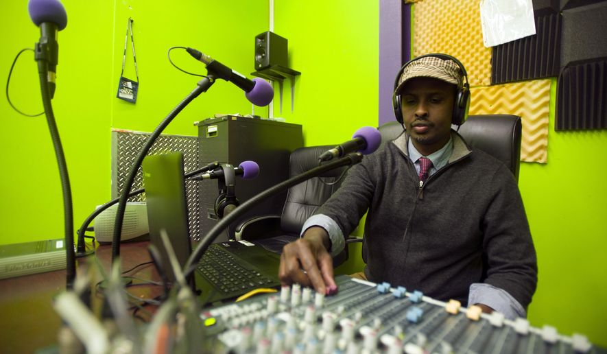 In this photo taken Dec. 9, 2015, Radio KALY axecutive director Mahamed Cali operates the mixing board during an on-air take  Minneapolis. Broadcasting on 101.7 FM, KALY is the first Somali-American radio station, looking to serve and further connect the Minneapolis Somali community. (Alex Tuthill-Preus/The Minnesota Daily via AP) MANDATORY CREDIT