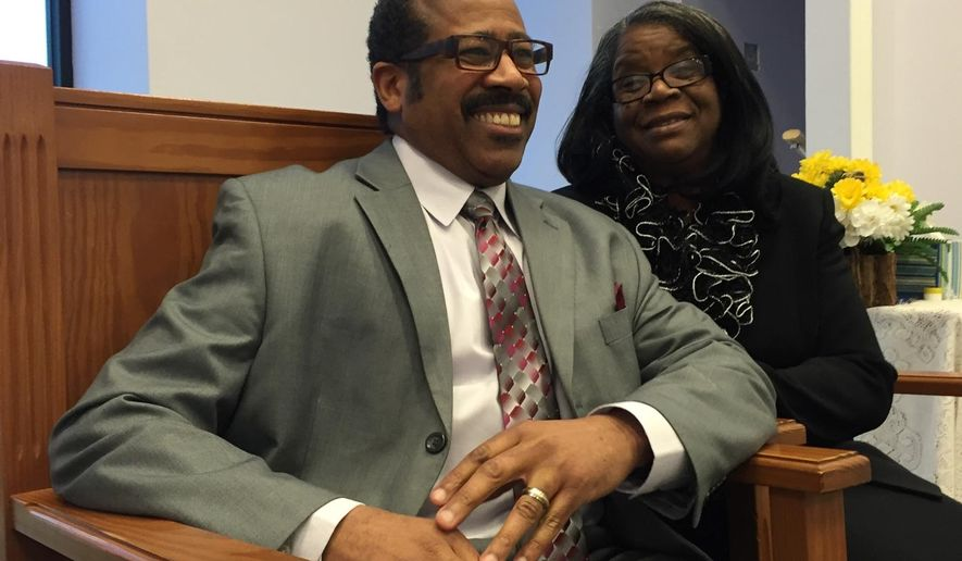 Rev. Anthony Walton, and his wife of 34 years, Deborah, lead Christ Temple in Paducah. Walton, who has a pastor since 2000, had been convicted in 1979 of armed robbery in Nashville and sentenced to 12 years, serving three years and two months. (Joshua Roberts/The Paducah Sun via AP) MANDATORY CREDIT