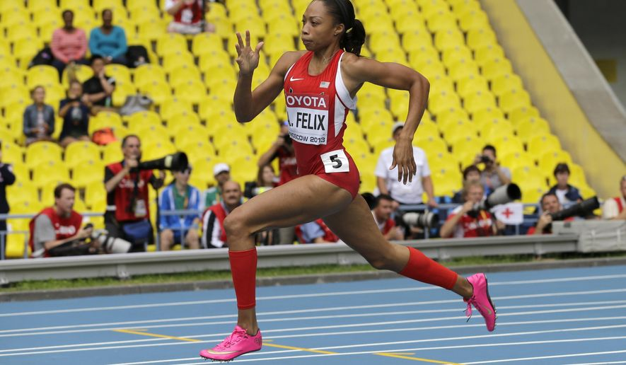 FILE - In this Aug. 15, 2013, file photo, United States' Allyson Felix competes in a women's 200-meter heat at the World Athletics Championships in Moscow. Felix's training is all geared toward the finish line in the 200 and 400 meters at the Rio Olympics. Schedule allowing, she hopes to be at the starting line for both races. Problem is, those events are scheduled to happen 75 minutes apart. (AP Photo/David J. Phillip, File)