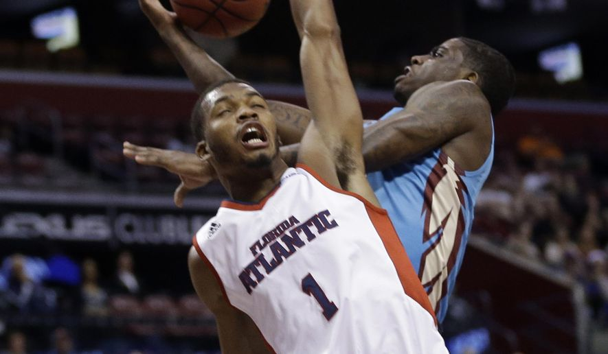 Florida State's Dwayne Bacon, right, is fouled by Florida Atlantic's Jeantal Cylla (1) the first half of the NCAA college Orange Bowl Basketball Classic, Saturday, Dec. 19, 2015, in Sunrise, Fla. (AP Photo/Lynne Sladky)