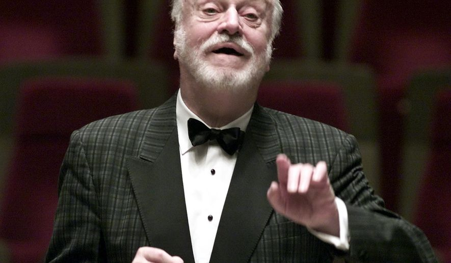 FILE - In this Oct. 10, 2001 file photo German conductor Kurt Masur conducts the London Philharmonic orchestra during a rehearsal in the concert hall Gewandhaus in Leipzig, eastern Germany. New York Philharmonic says music director emeritus Kurt Masur, from Germany, has died at 88. (AP Photo/Eckehard Schulz, file)