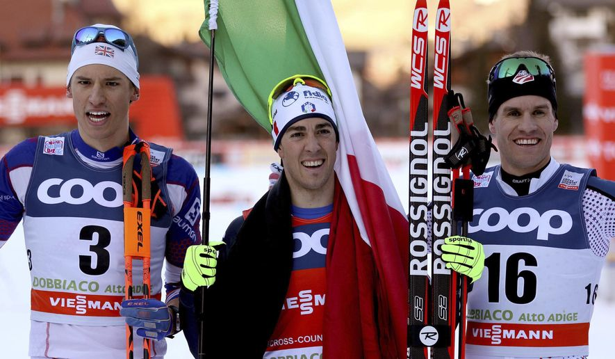 Federico Pellegrino, of Italy, center, winner of a men's World Cup cross-country ski sprint event, poses with second placed Simeon Hamilton, of the United States, right, and third placed Andrew Young, of Britain, in Dobbiaco, Italy, Saturday, Dec. 19, 2015. (Luciano Solero/ANSA via AP)