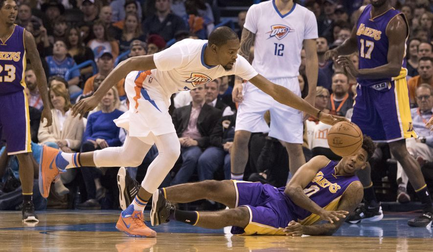 Oklahoma City Thunder forward Kevin Durant (35) chases the ball as Los Angeles Lakers forward Nick Young (0) falls to court during the first half of an NBA basketball game in Oklahoma City, Saturday, Dec. 19, 2015. (AP Photo/J Pat Carter)