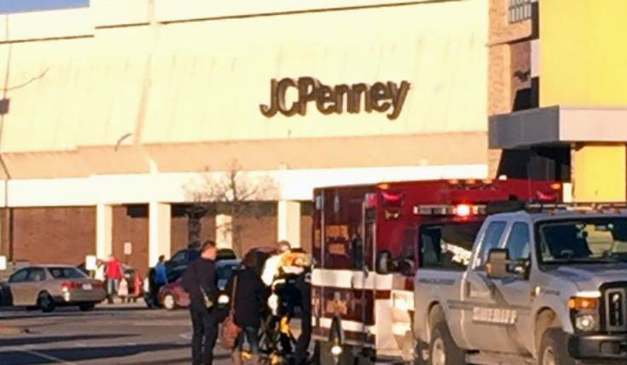 In this photo provided by NBC15 Madison, authorities respond to reports of shots fired at the East Towne Mall in Madison, Wis., Saturday, Dec. 19, 2015. (Sharon Yoo/NBC15 Madison via AP) MANDATORY CREDIT