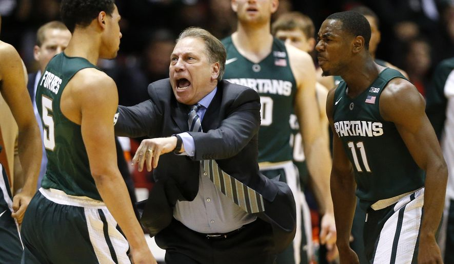 Michigan State head coach Tom Izzo shouts at Michigan State's Bryn Forbes (5) during the first half of an NCAA college basketball game against Northeastern in Boston Saturday, Dec. 19, 2015. (AP Photo/Winslow Townson)