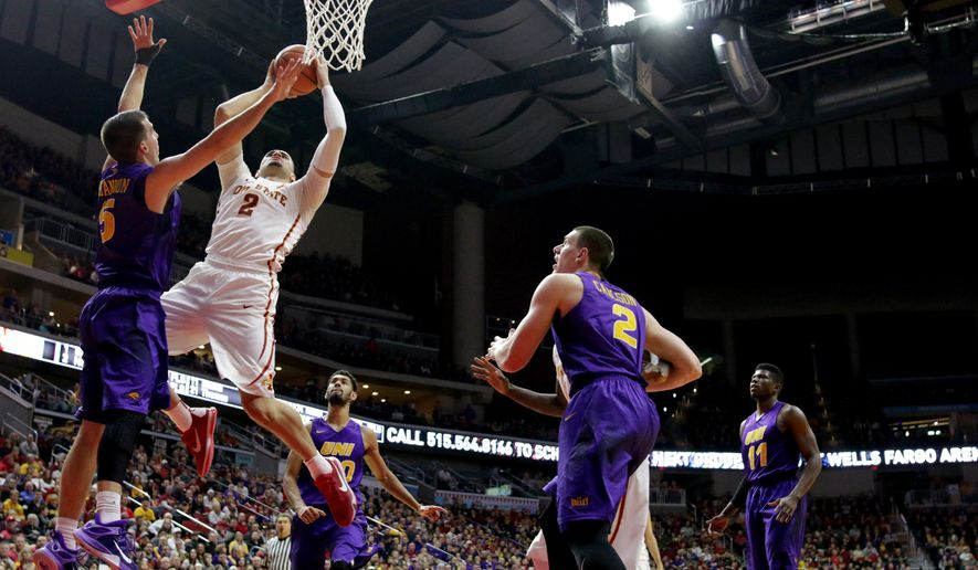 Iowa State forward Abdel Nader (2) shoots over Northern Iowa guard Matt Bohannon during the first half of an NCAA college basketball game, Saturday, Dec. 19, 2015, in Des Moines, Iowa. (AP Photo/Justin Hayworth)