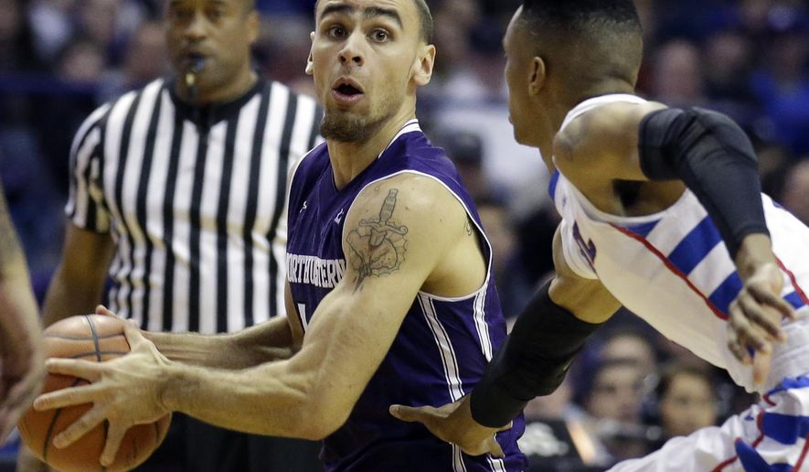 Northwestern guard Tre Demps, left, looks to pass against DePaul guard Darrick Wood during the first half of an NCAA college basketball game on Saturday, Dec. 19, 2015, in Rosemont, Ill. (AP Photo/Nam Y. Huh)