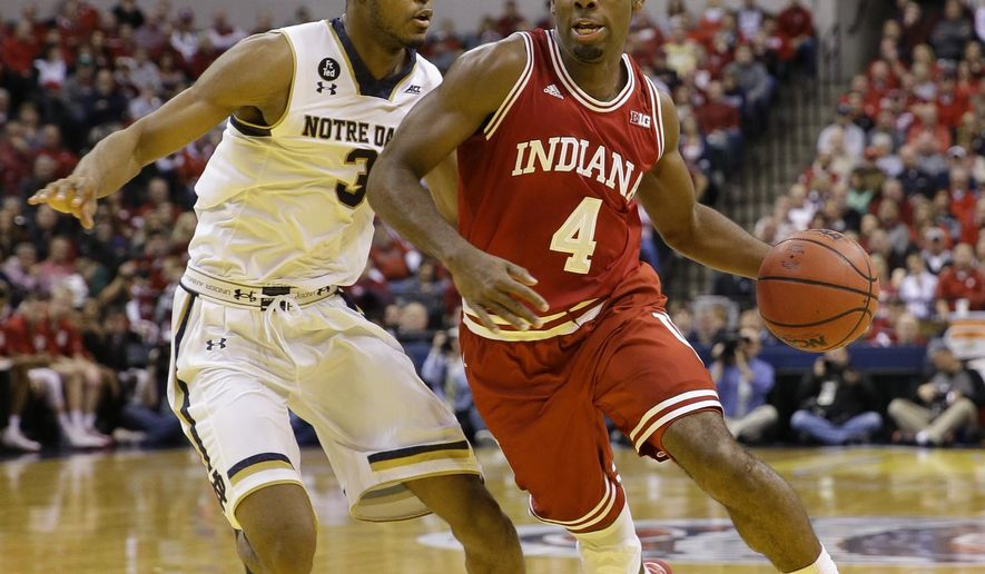 Indiana guard Robert Johnson (4) drives past Notre Dame forward V.J. Beachem (3) in the first half of an NCAA college basketball game in Indianapolis, Saturday, Dec. 19, 2015. Indiana defeated Notre Dame 80-73. (AP Photo/Michael Conroy)