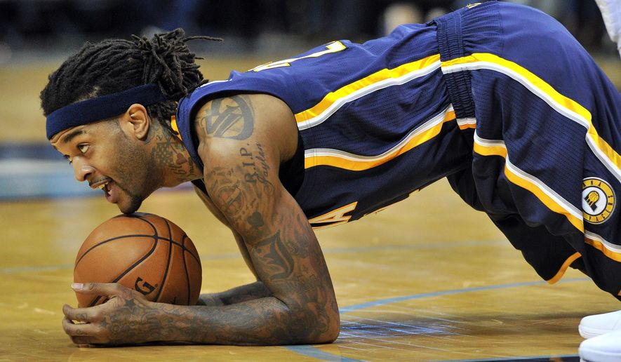 Indiana Pacers center Jordan Hill lies on the ball after a play in the second half of an NBA basketball game against the Memphis Grizzlies Saturday, Dec. 19, 2015, in Memphis, Tenn. (AP Photo/Brandon Dill)