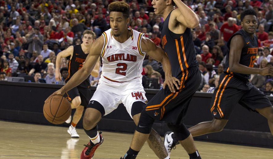 Maryland's Melo Trimble (2) drives the ball as Princeton's  Devin Cannady (3) defends during the first half of an NCAA college basketball game at Royal Farms Arena in Baltimore, Md., Saturday, Dec. 19, 2015. (AP Photo/Jose Luis Magana)