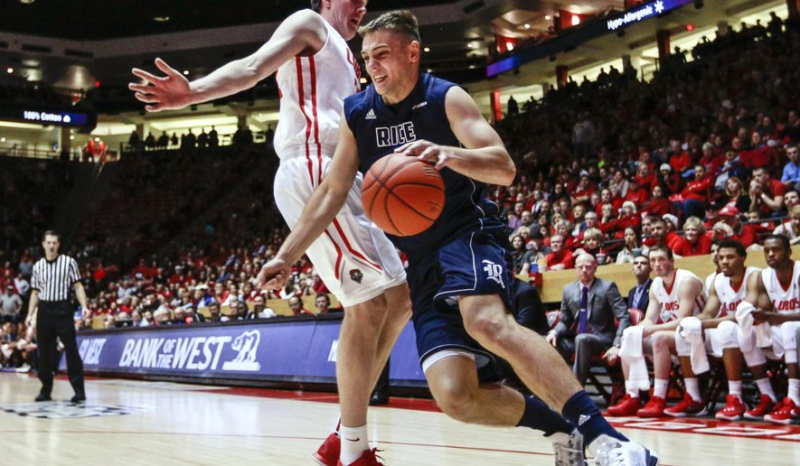 Rice's Egor Koulechov (4) moves around New Mexico's Joe Furstinger (23) near the baseline during the first half an NCAA college basketball game, Saturday, Dec. 19, 2015, in Albuquerque, N.M. (AP Photo/Juan Labreche)