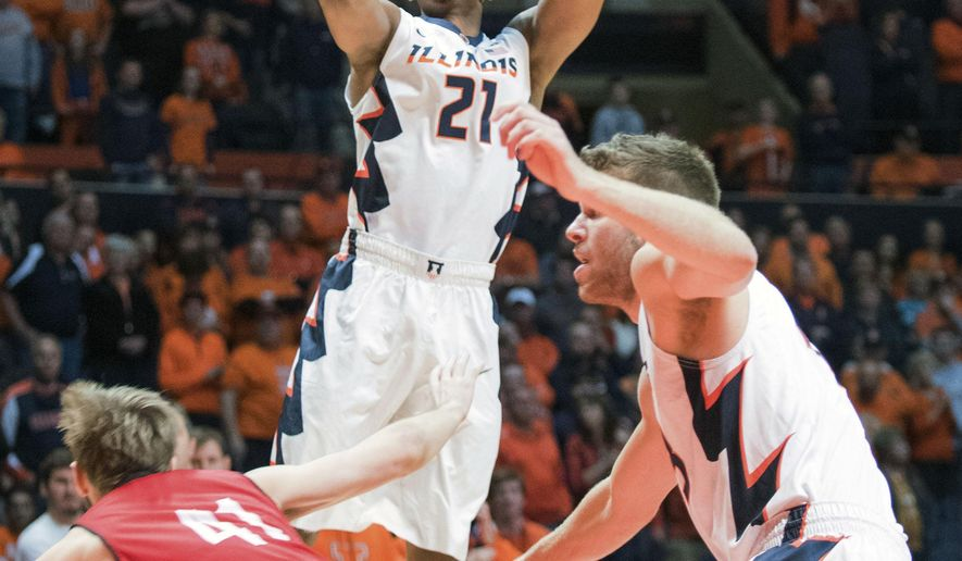 Illinois' guard Malcolm Hill (21) shoots over South Dakota's forward Eric Robertson (41) during the second half of an NCAA college basketball game Saturday, Dec. 19, 2015 in Champaign, Ill. Illinois won 91-79. (AP Photo/Robin Scholz)