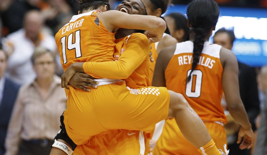 Tennessee's Andraya Carter, left, and Meme Jackson celebrate Tennessee's 53-50 win over Oregon State in an NCAA college basketball game, in Corvallis, Ore., on Saturday, Dec. 19, 2015. (AP Photo/Timothy J. Gonzalez)