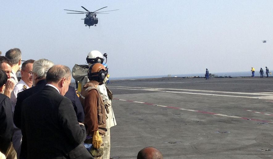"""The helicopter carrying U.S. Secretary of Defense Ash Carter arrives on the French aircraft carrier Charles de Gaulle in the Persian Gulf Saturday, Dec. 19, 2015. The American airstrike that may have killed a number of Iraqi soldiers on Friday seems to be """"a mistake that involved both sides,"""" Carter said Saturday. He called Iraqi Prime Minister Haider al-Abadi to express condolences. (AP Photo/Lolita Baldor)"""