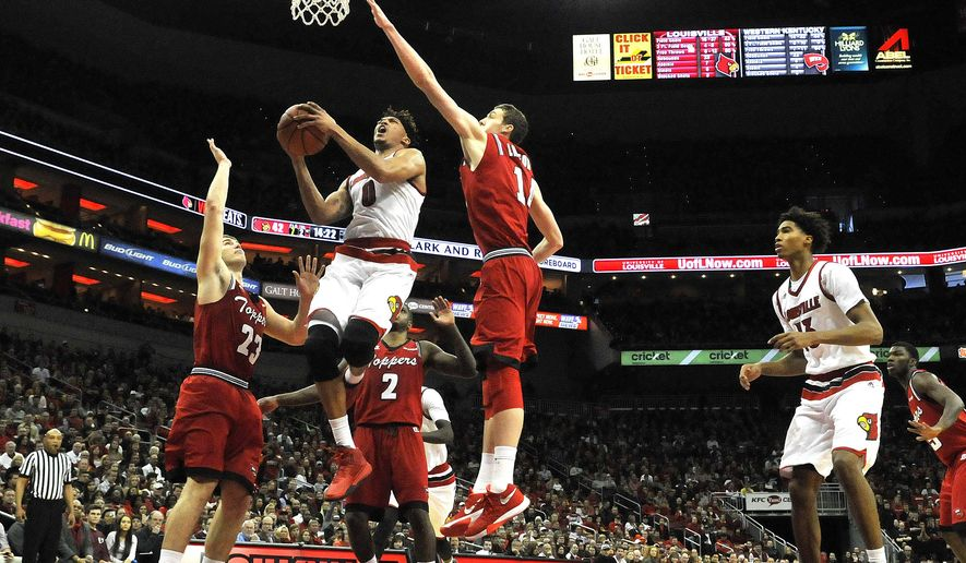 Louisville's Damion Lee (0) splits the defense of Western Kentucky's Justin Johnson (23) and Ben Lawson (14) for a layup during the second half of an NCAA college basketball game, Saturday, Dec. 19, 2015, in Louisville, Ky. Louisville won 78-56. (AP Photo/Timothy D. Easley)