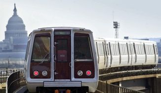 A Metrorail train is shown with U.S. Capitol in the background in this file photo. (Associated Press) **FILE**