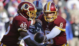 Washington Redskins quarterback Kirk Cousins (8) hands the ball off to running back Alfred Morris (46) during the first half of an NFL football game against the Buffalo Bills in Landover, Md., Sunday, Dec. 20, 2015. (AP Photo/Mark Tenally)