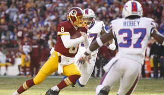 Washington Redskins quarterback Kirk Cousins (8) heads downfield towards a touchdown during the first half of an NFL football game against the Buffalo Bills in Landover, Md., Sunday, Dec. 20, 2015. (AP Photo/Andrew Harnik)