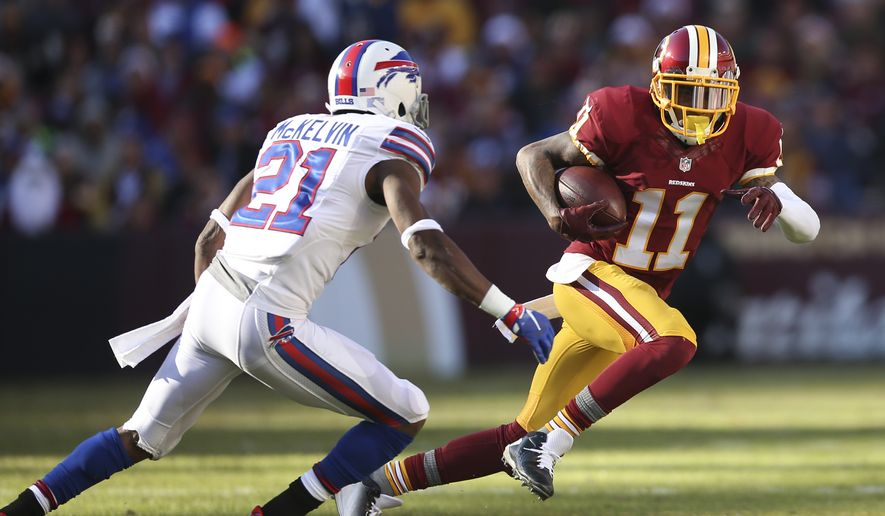 Washington Redskins wide receiver DeSean Jackson (11) carries the ball past Buffalo Bills strong safety Leodis McKelvin (21) during the first half of an NFL football game in Landover, Md., Sunday, Dec. 20, 2015. (AP Photo/Andrew Harnik)
