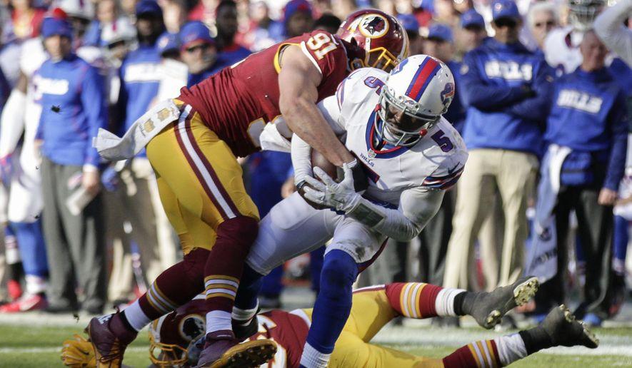 Washington Redskins outside linebacker Ryan Kerrigan (91) tackles Buffalo Bills quarterback Tyrod Taylor (5) during the first half of an NFL football game in Landover, Md., Sunday, Dec. 20, 2015. (AP Photo/Mark Tenally)