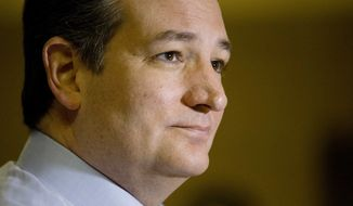 Republican presidential candidate Sen. Ted Cruz, R-Texas, speaks to the media during a campaign stop on Sunday, Dec. 20, 2015, in Trussville, Ala. (AP Photo/Brynn Anderson)