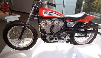"""The Harley-Davidson XR-750 is a racing motorcycle made by Harley-Davidson since 1970, primarily for dirt track racing, but also for road racing in the XRTT variant. The XR-750 was designed in response to a 1969 change in AMA Grand National Championship rules that leveled the playing field for makes other than Harley-Davidson, allowing Japanese and British motorcycles to outperform the previously dominant Harley-Davidson KR race bike. The XR-750 went on to become the winningest race bike in the history of American Motorcyclist Association (AMA) racing. The XR-750 is associated with the careers of racers Mark Brelsford, Cal Rayborn, and Jay Springsteen, and was the favorite motorcycle of stunt performer Evel Knievel. Knievel used the bike from December 1970 until his final jump in January 1977. An XR-750 was included in the 1998 The Art of the Motorcycle exhibition, and one of Knievel's bikes is in the Smithsonian'sNational Museum of American History America on the Move exhibit. Riders on XR-750s have won 29 of the 37 AMA Grand National Championships from 1972 to 2008 inclusive.  Besides having more wins than any other bike in AMA racing, it has been called the """"most successful race bike of all time"""", and has a claim to have more wins than any other racing motorcycle in history."""
