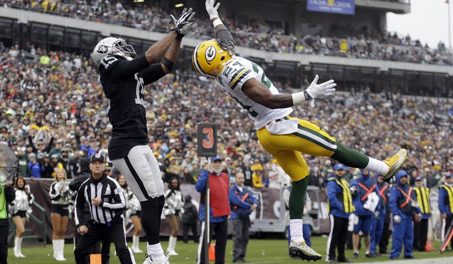 Green Bay Packers cornerback Quinten Rollins (24) breaks ups a pass intended for Oakland Raiders wide receiver Michael Crabtree (15) during the first half of an NFL football game, Sunday, Dec. 20, 2015, in Oakland, Calif. (AP Photo/Ben Margot)