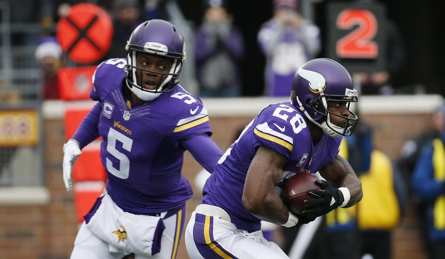 Minnesota Vikings quarterback Teddy Bridgewater (5) hands off to running back Adrian Peterson (28) during the first half of an NFL football game against the Chicago Bears, Sunday, Dec. 20, 2015, in Minneapolis. (AP Photo/Alex Brandon)