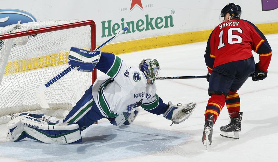 Florida Panthers forward Aleksander Barkov (16) scores the winning goal past Vancouver Canucks goaltender Jacob Markstrom (25) during the shootout period of an NHL hockey game, Sunday, Dec. 20, 2015, in Sunrise, Fla. The Panthers defeated the Canucks 5-4. (AP Photo/Joel Auerbach)
