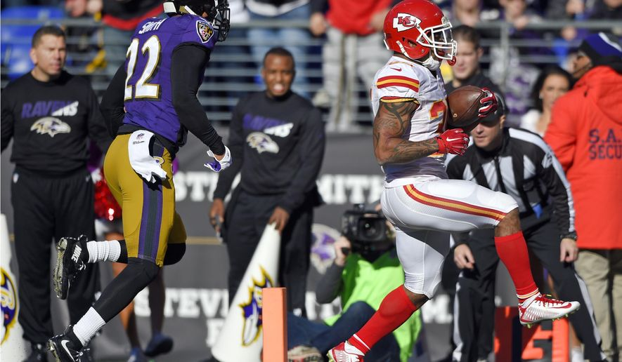 Kansas City Chiefs running back Charcandrick West, right, scores a touchdown in front of Baltimore Ravens cornerback Jimmy Smith in the first half of an NFL football game, Sunday, Dec. 20, 2015, in Baltimore. (AP Photo/Nick Wass)