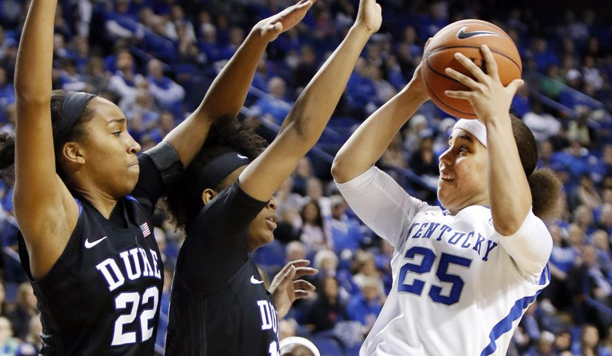 From left, Duke's Oderah Chidom and Crystal Primm defend the shot of Kentucky's Makayla Epps during an NCAA college basketball game, Sunday, Dec. 20, 2015, in Lexington, Ky. (AP Photo/James Crisp)