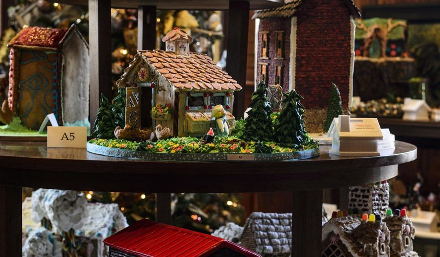 ADVANCE FOR SUNDAY DEC. 20 AND THEREAFTER - In this photo taken, Friday Dec. 11, 2015, gingerbread houses are displayed at the Blennerhassett Hotel in Parkersburg, W.Va. Voting proceeds will be given to Habitat for Humanity.  (Sam Owens/Charleston Gazette-Mail via AP) MANDATORY CREDIT
