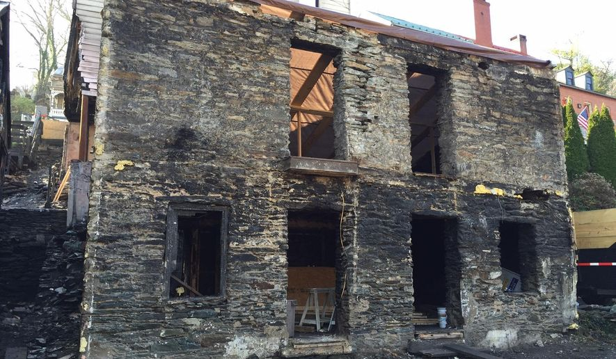 ADVANCE FOR DEC. 20 AND THEREAFTER - A December 10, 2015 photo shows one of the four buildings destroyed in the July 2015 fire in Harpers Ferry. The building is in the process of having debris removed,moving toward rebuilding. It's been nearly five months since a fire broke out in Harpers Ferry that devastated its historic commercial district and caused millions of dollars in damages. Since that day, the town of Harpers Ferry has moved quickly toward recovery and is getting close to rebuilding. (Liz McCormick/West Virginia Public Broadcasting via AP)