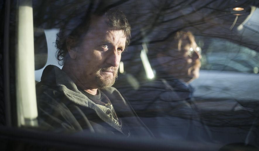 ADVANCE FOR WEEKEND EDITIONS, DEC. 19-20 - In this photo taken Thursday, Dec. 10, 2015, Kevin Arbogast, left, of Yakima, sits in the passenger seat of his Peer Support Counselor, David Scofield, at Central Washington Comprehensive Mental Health in Yakima, Wash. Scofield will pick up his clients from their homes and help with everyday activities. Counselors meet with clients on an as-needed basis. (Mason Trinca/Yakima Herald-Republic via AP) MANDATORY CREDIT