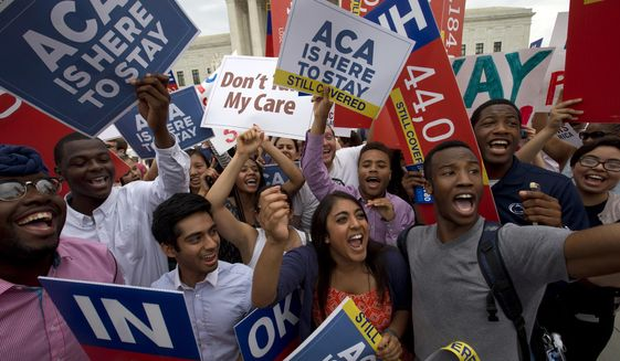 In this June 25, 2015, photo, students cheer as they hold up signs outside of the Supreme Court in Washington, supporting the Affordable Care Act after the Supreme Court decided that the ACA may provide nationwide tax subsidies. (AP Photo/Jacquelyn Martin) **FILE**