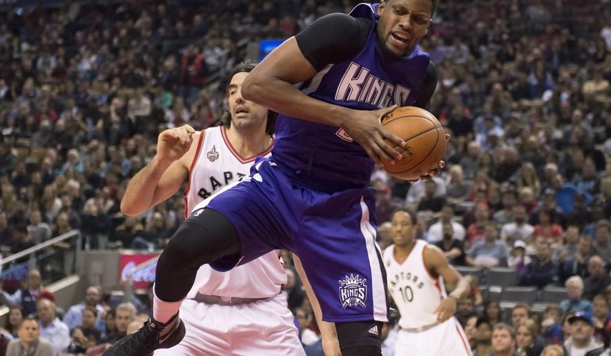 Sacramento Kings forward Rudy Gay, front, rebounds against Toronto Raptors forward Luis Scola during the first half of an NBA basketball game in Toronto on Sunday, Dec. 20, 2015. (Frank Gunn/The Canadian Press via AP) MANDATORY CREDIT