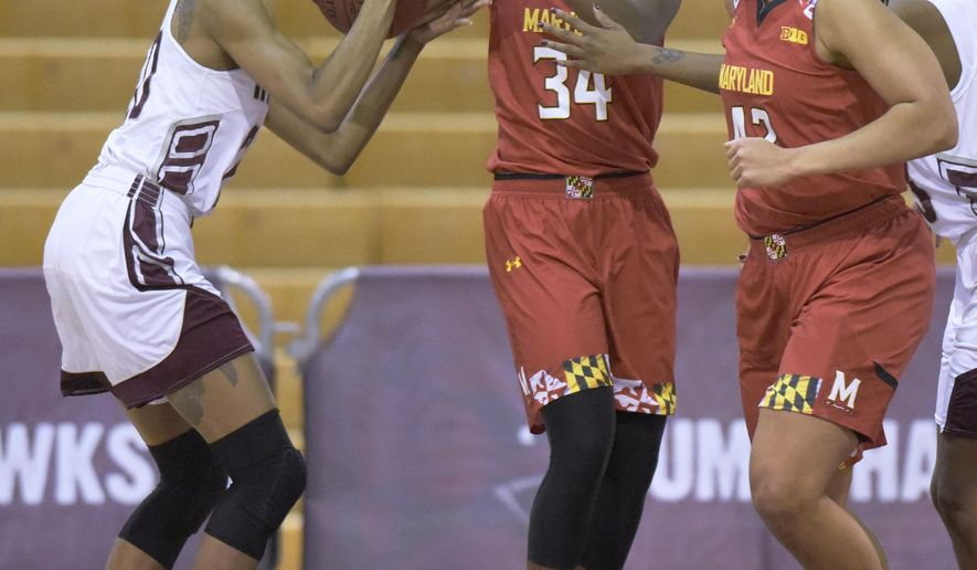 From left to right, Maryland Eastern Shore forward Alexis Udoji, Maryland guard Brianna Fraser, Maryland center Brionna Jones, and Maryland Eastern Shore center Taryana Kelly vie for a ball in the first half of an NCAA college basketball game, Sunday, Dec. 20, 2015, in Princess Anne, Md. (AP Photo/Steve Ruark)