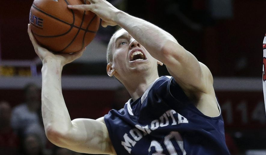 Monmouth guard Collin Stewart (30) takes a shot  during the first half of an NCAA college basketball game against Rutgers  Sunday, Dec. 20, 2015, in Piscataway, N.J.  (AP Photo/Mel Evans)