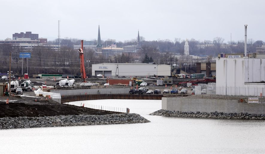 In this Friday, Dec. 18, 2015, photo, construction work continues at Mohawk Harbor where the Rivers Casino & Resort at Mohawk Harbor is proposed in Schenectady, N.Y. Three casinos planned for upstate New York are poised to receive their state licenses after a year-long wait. The formal licensure will allow the projects to proceed with construction and financing. (AP Photo/Mike Groll)